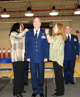 On hand to pin on the eagle insignia were his wife, Antonina, and sister, retired Air Force Master Sgt. Madonna Rogers. Col. Rogers joined the 107th Airlift Wing in 1984 as an enlisted Airman in the base supply section. He has studied hard and worked his way up the ranks. Col. Rogers graduated from the State University of New York College at Buffalo in 1990 then received his commission as an officer in 1991.Oct. 13, 2012 (U.S. Air Force Photo/Senior Master Sgt. Ray Lloyd)