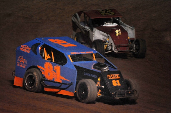 """Master Sgt. Paul Ording, 154th Training Squadron aircrew flight equipment technician, takes the lead in the number four turn in the #81 during the modified lite """"B"""" feature at the I-30 Speedway July 7, 2012, in Little Rock, Ark.  Ording won rookie of the year of the Year for the ADCRA and Rookie of the Year for the I-30 track in while racing in 2011. Air Force photo by SSgt. Chad Chisholm"""