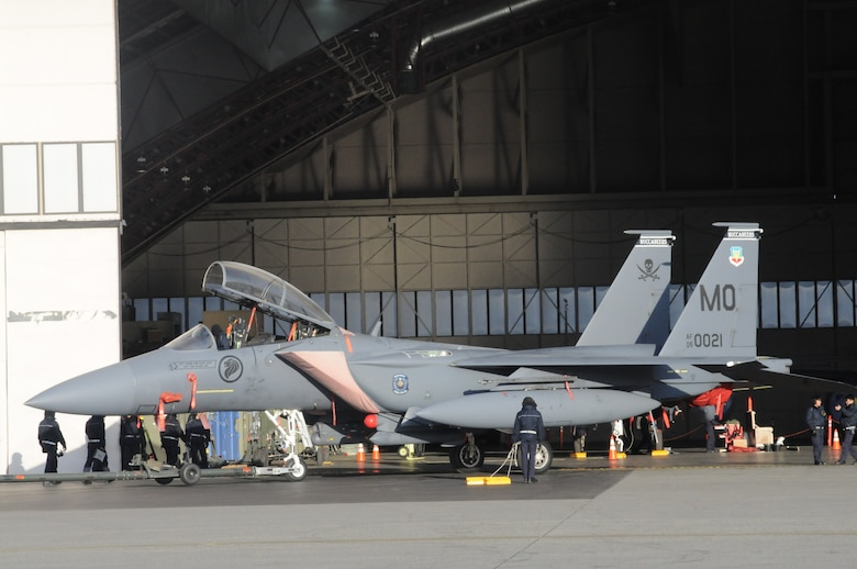 A Republic of Singapore Air Force F-15SG is towed inside a hangar for minor repairs Oct. 12, 2012, at Eielson Air Force Base, Alaska. The severe weather and rigorous flight schedule can sometimes cause minor issues requiring maintainers to pull the aircraft from daily operations until all safety checks and repairs have been accomplished. (U.S. Air Force photo/Senior Airman Benjamin Sutton/Released)