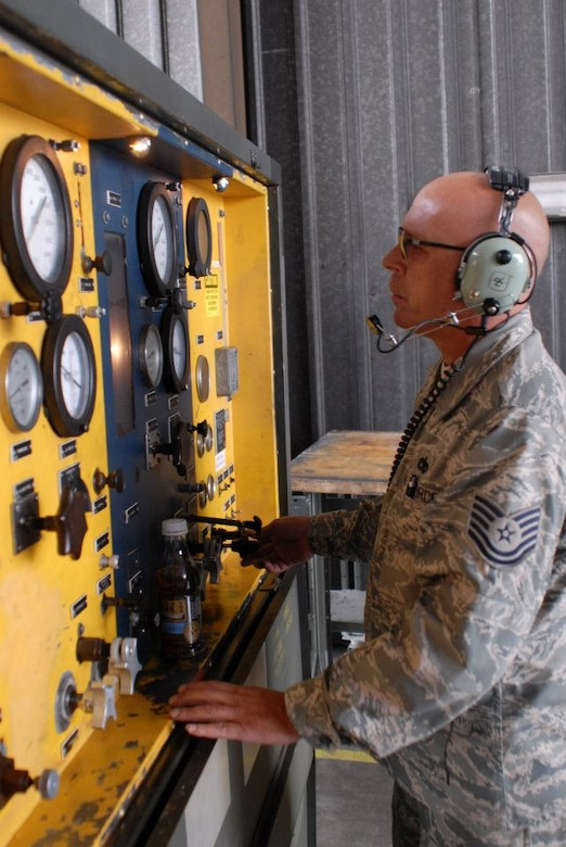 """Tech Sgt. Edmund Poitinger a pneudraulics mechanic from the 180th Fighter Wing in Toledo, Ohio, operates a hydraulic test stand while troubleshooting a landing gear problem for an F16 in Great Falls, Montana, August 3, 2012. Members of the 180FW travelled to Great Falls, Montana to participate in exercise """"Hang em' High"""" to practice dissimilar air combat training. (U.S. Air Force photo by Staff Sgt. Stephen Reddick/Released)"""