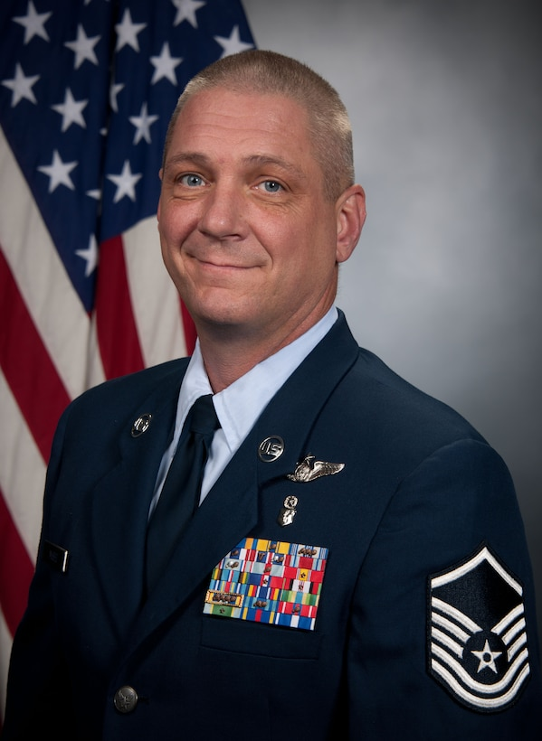 Master Sgt. Shannon McBee poses for his official photo after being nominated for the 2013 Noncommissioned Officer Association Vanguard Award. McBee saved a man's life while on a flight from Atlanta to San Antonio. (Submitted photo)