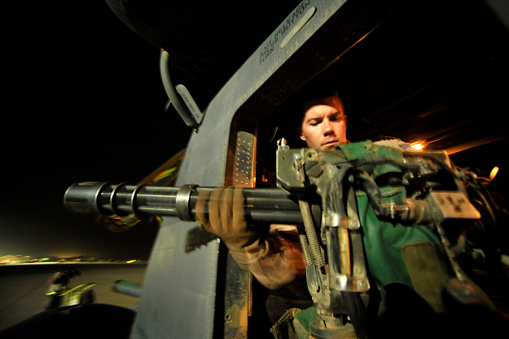 Tech. Sgt. Corey Fossbender, 20th Expeditionary Special Operations Squadron arial gunner, checks his mini gun prior to the last combat mission of the MH-53 Pave Low helicopter Sept. 27, 2008 during Operation Iraqi Freedom. The operation began in March 2003, when AFSOC deployed forces to Southwest Asia to remove Saddam Hussein from power and liberate the Iraqi people. The command's personnel and aircraft teamed with other SOF and conventional forces to quickly bring down Saddam Hussein's government by May 2003. To ensure the seeds of democracy had time to grow in Iraq, AFSOC forces continued to conduct operations well into 2010. (U.S. Air Force photo by Staff Sgt. Aaron Allmon)