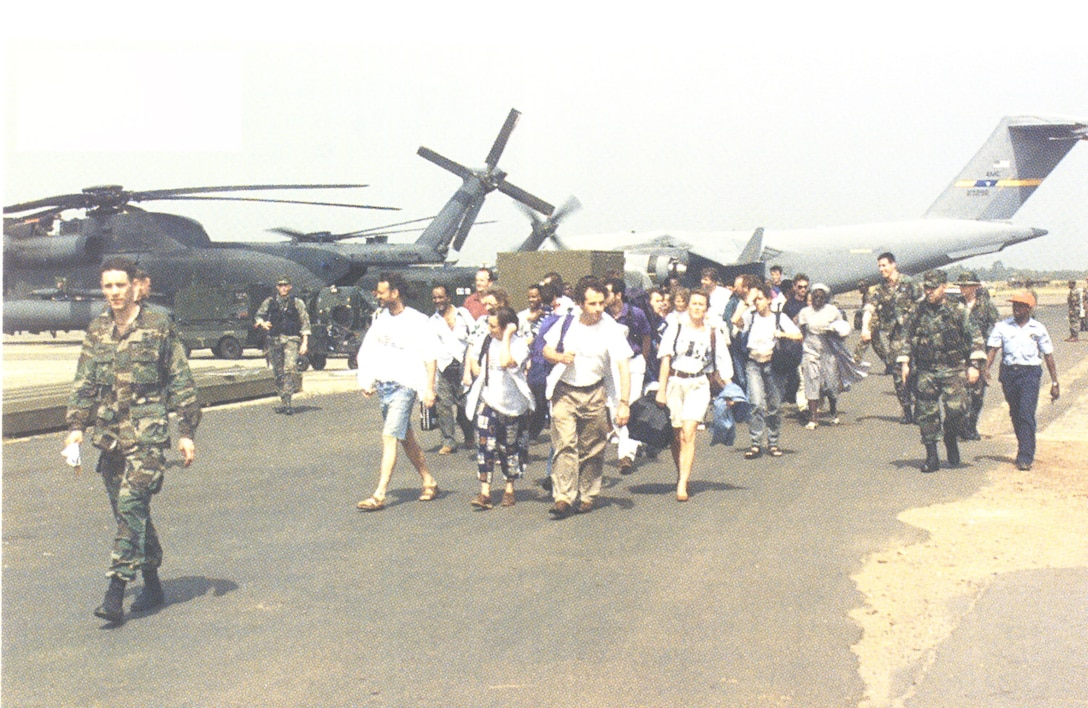 During Operation Assured Response, Special Operations Forces successfully evacuate more than 2,000 people out of the United States Embassy in Liberia, Africa. Operating in a hostile fire environment, SOF personnel conducted dozens of rotary wing evacuation flights using MH-53Js and overhead fire support sorties from AC-130H Spectres, often vectoring friendly aircraft through small arms and rocket propelled grenades. For their efforts, Pave Low crews were presented the Tunner Award as the outstanding strategic airlift crew of the year. (courtesy photo)