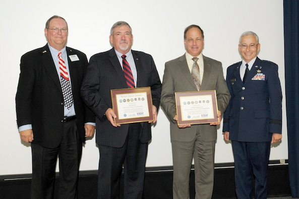 """Bill """"Top"""" Parsons,center left, Air Force chief of ground safety, and Bill Walkowiak, center right, Air Force deputy chief of ground safety, received Employer Support of the Guard and Reserve Patriot Awards for outstanding support of their employees who are members of the Air Force Reserve.The awards were presented Oct. 3 at the Air Force Safety Center, Kirtland Air Force Base, N.M. Making the presentations were Gary Kaiser, left, ESGR program support manager, and Brig. Gen. Andrew Salas, right, New Mexico adjutant general. (U.S. Air Force photo/Keith Wright)"""