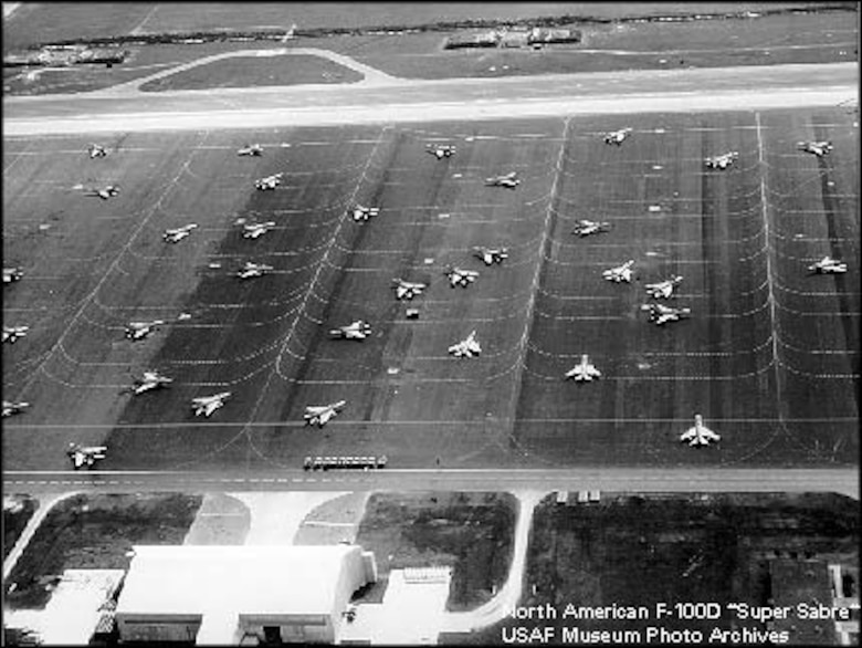 More than 30 F-100 Super Sabres sit on the flightline at Homestead Air Force Base, Fla., ready to respond at a moments notice during the Cuban Missile Crisis in 1962.  Aircraft were parked sporadically on the flightline to minimize damage in the event of an attack during the Cuban Missile Crisis.(courtesy photo)