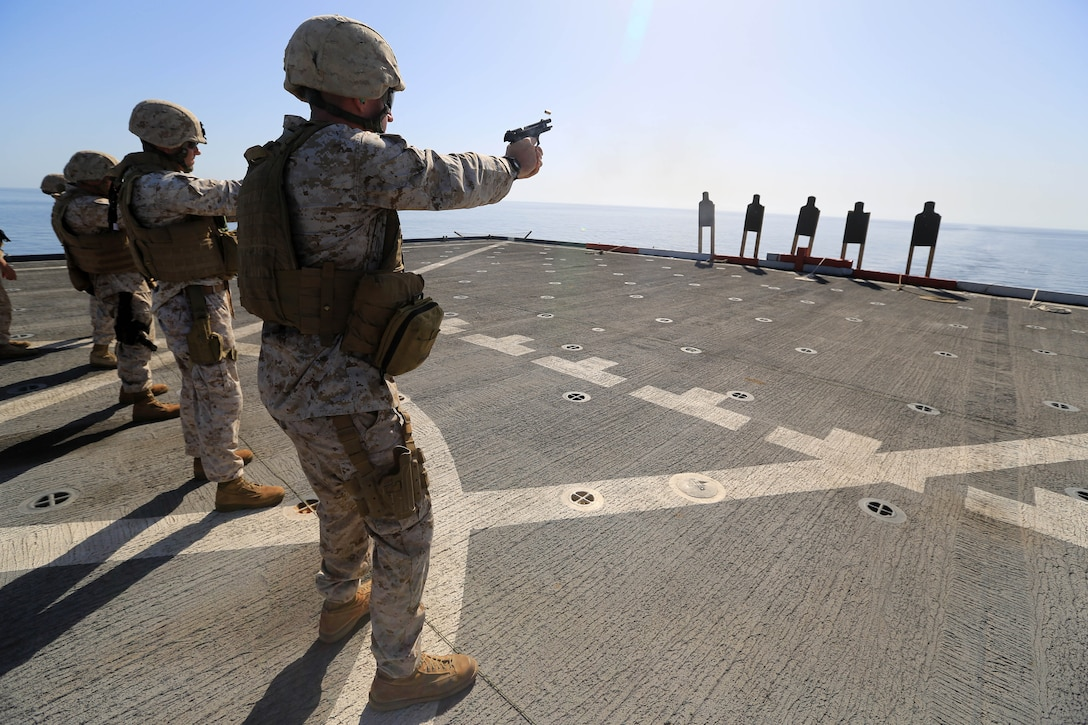 USS GUNSTON HALL, Gulf of Oman (Oct. 5, 2012) - Marines with Combat Logistics Battalion 24, 24th Marine Expeditionary Unit, fire M-9 Beretta pistols during sustainment training on the flight deck of the USS Gunston Hall in the Gulf of Oman, Oct. 5, 2012. The 24th MEU is deployed with the Iwo Jima Amphibious Ready Group as a theater reserve and crisis response force for U.S. Central Command in the U.S. Navy's 5th Fleet area of responsibility.