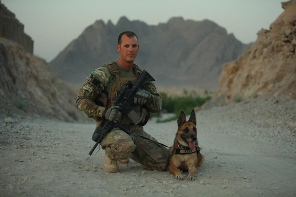 Staff Sgt. Leonard Anderson, 354th Security Force Squadron military working dog handler, poses for a photo with Azza, his military working dog, during a recent deployment to Afghanistan. (Courtesy photo)