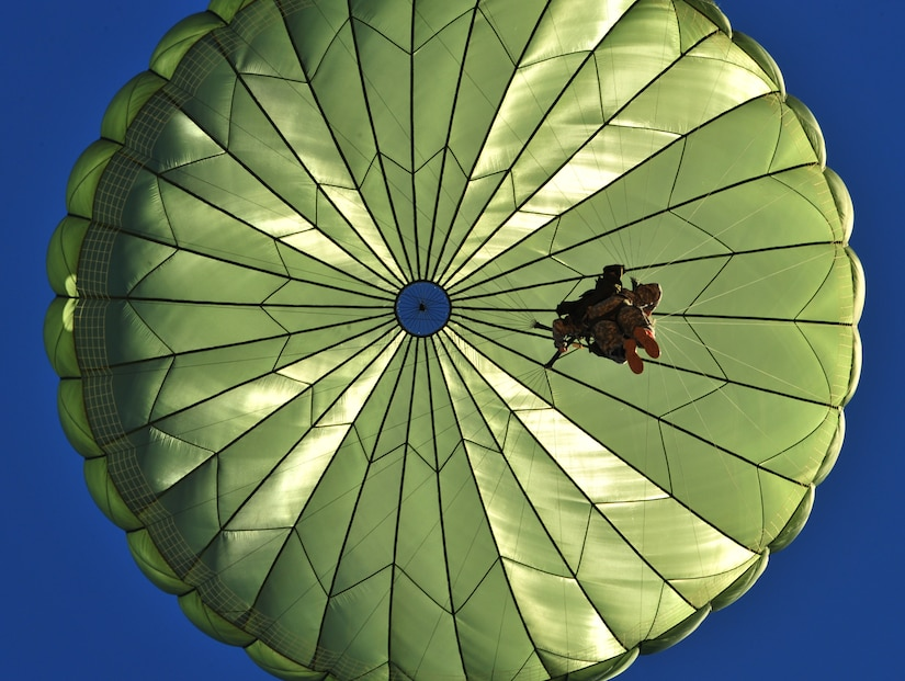 A U.S. Army Paratrooper from the 82nd Airborne Division, Fort Bragg, N.C., participates in a personnel drop during Large Package Week that happens in conjunction with Joint Operational Access Exercise, Oct. 11, 2012. LPW is an exercise that utilizes several Air Force aircraft to strategically airdrop troops and cargo. (U.S. Air Force photo/ Staff Sgt. Elizabeth Rissmiller)