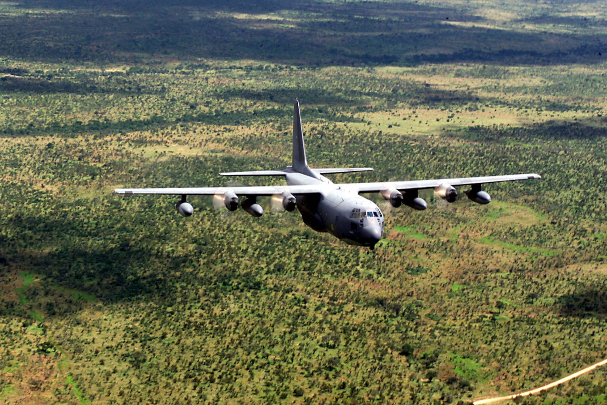 """An MC-130 participates in Mozambique flood relief effort in March 2000 during Operation Atlas Response. Relief operations focused on providing food, water and medical supplies to more than 650,000 people in Africa.  Joint Task Force personnel mapped """"hot spots"""" where people were at risk. They also used infrared cameras to identify road and rail breaks that could be repaired quickly to expedite aid delivery instead of relying almost solely on airlift. (courtesy photo)"""