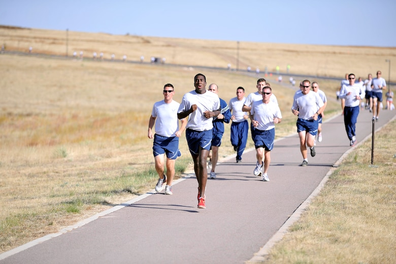 Members of the 50th Space Wing participate in the monthly Warfit Run Oct. 11 at the main fitness center. The run is designed to promote fitness and camaraderie.  (U.S. Air Force photo/Bill Evans)