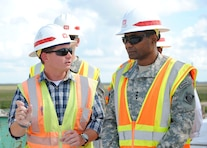 Chris Rego, U.S. Army Corps of Engineers Jacksonville District civil engineer, discusses construction of the Tamiami Trail Modifications project with Lt. Gen. Thomas P. Bostick, commanding general of the U.S. Army Corps of Engineers Oct 10, 2012.