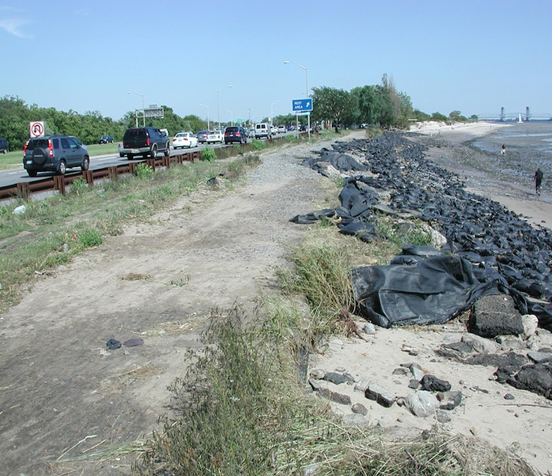 This photo shows eroded areas of Plumb Beach in Brooklyn after Hurricane Irene hit in 2011. The erosion is threatening the Belt Parkway, which is a critical piece of New York City's infrastructure. The U.S. Army Corps of Engineers, New York District, working in partnership with the New York City Department of Parks & Recreation and the National Park Service, started sand placement there October 12, 2012, which is the first phase of coastal storm risk reduction work there.