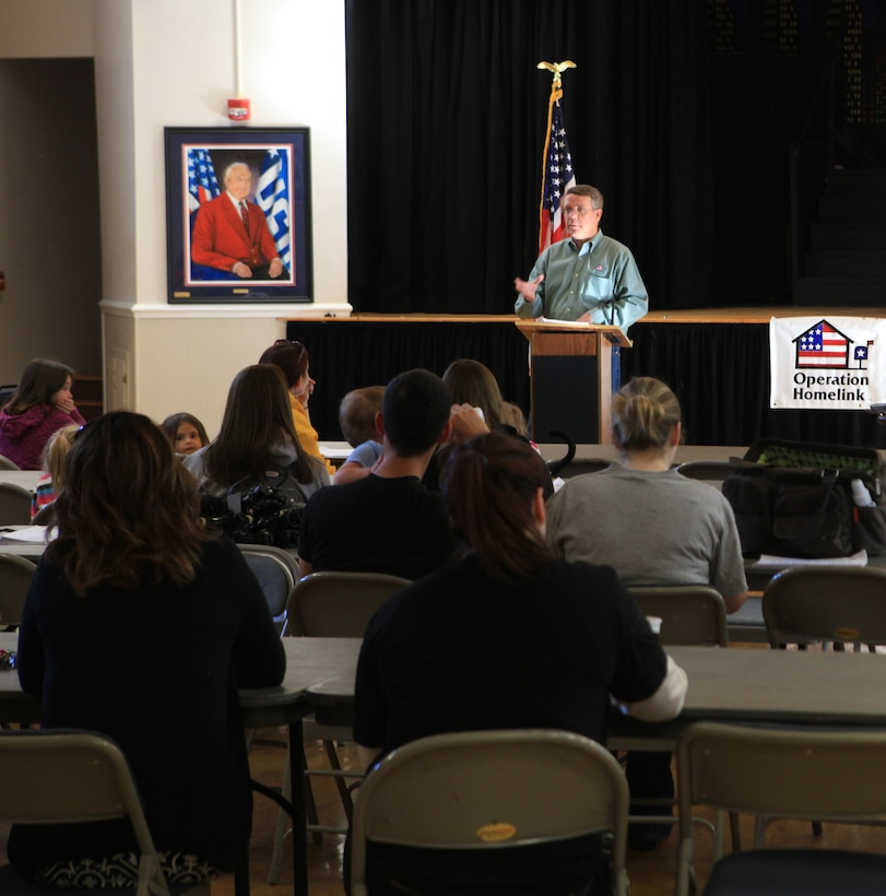 Dan Shannon, president and founder of Operation Homelink, gives a speech to the families of service members Saturday morning at the USO North Carolina Jacksonville. Before giving the families a laptop and webcam donated by supporting corporations, Shannon, explained why it was important for these families to communicate with their loved ones. Also he gave brief history of the organization and re-stated how much, the families and service members are appreciated for their sacrifices being made on behalf of the 99 percent of Americans who aren't serving.