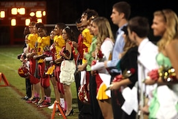 Lejeune High School's homecoming court stands in front of the crowd as they are each announced over the microphone at halftime during their homecoming game against Pamlico County High School Friday. The freshmen, sophomores and juniors each had four representatives on the court and the senior class had six representatives. Official Marine Corps photo by Lance Cpl. Scott W. Whiting)