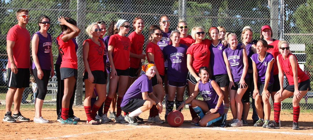 The winners of the kickball tournament, the Lejeunatics, and the runners-up, the Lady Raiders, pose for a photo.  Spouses of Marines and sailors competed in the Spouses Lejeune Area Kickball Association or SLAKA Oct. 13-14.  Most of the spouses were wives of Marines and sailors aboard Camp Lejeune, but husbands and spouses from other commands could also share in the camaraderie.