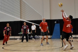 Team Red Devils compete against Team MCTSSA during the Commanding General's Volleyball Tournament at Camp Pendleton's Camp Horno Fitness Center, Oct. 16.