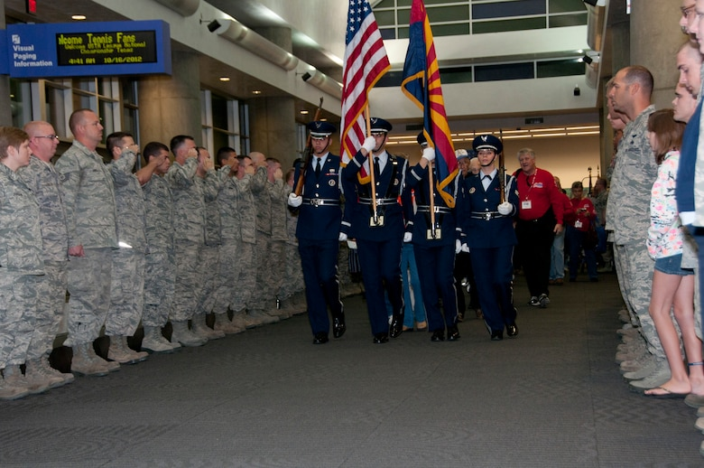 Davis-Monthan Air Force Base honor guard presents the colors during the WWII Veterans Honor Flight send-off at Tucson International Airport. (U.S. Air Force photo by Master Sgt. David Neve)