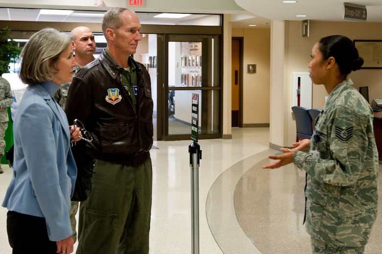 Air Force Tech. Sgt. Sonyea Woolfolk, 28th Medical Support Squadron pharmacy NCO in charge, provides information about pharmacy operations to Gen. Mike Hostage, commander of Air Combat Command, and his wife, Kathy, during their tour of the 28th Medical Group at Ellsworth Air Force Base, S.D., Oct. 10, 2012. Hostage visited Ellsworth to see firsthand the mission being accomplished by the Airmen providing expeditionary combat power. (U.S. Air Force photo by Airmen 1st Class Kate Thornton-Maurer/ Released)