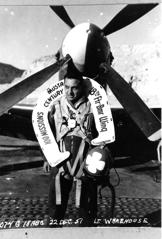 Oregon Air Guardsman Ernest Wakehouse celebrates completion of his 100th combat mission in Korea, which he flew on December 16, 1951.