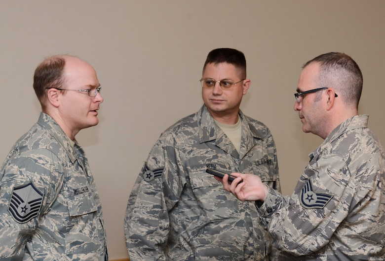 """Master Sgt. Michael Wollenzien, (left) 133rd Communications Flight and Senior Airman Gunther Heeb, (center) 133rd Operations Support Flight of the Minnesota Air National Guard were sworn into the Kentucky Air National Guard Oct. 13, 2012 during a ceremony at the St. Paul Air National Guard base and were interviewed by Staff Sgt. Jonathan Young of the 133rd AW public affairs office. """"The degree in which the Minnesota National Guard has demonstrated its incredible excellence across the board with its flying units and now its cyber opportunities really show that we are on the leading edge, the tip of the spear,"""" said Brig. Gen. Worthe S. Holt, Jr., the Assistant Adjutant General-Air for the Minnesota National Guard as he presided over the reenlistment. U.S. Air Force photo by Tech. Sgt. Erik Gudmundson/released"""