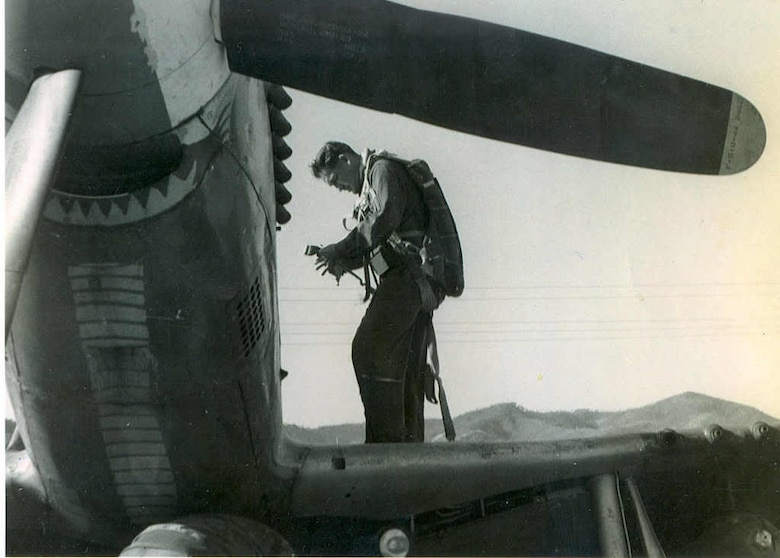 "Oregon Air Guardsman Greg James prepares to embark on a combat mission in an F-51 Mustang fighter-bomber.  Note the ""cobra"" markings on the belly of his plane, indicating this was the aircraft of the fellow squadron member John ""JET"" Taylor.  An intense warrior and candidate for the ultimate fighter pilot, Taylor had a cobra, representing the 39th Fighter Interceptor Squadron, painted along the entire length of the bottom of the fuselage of his Mustang because he wanted the enemy to know who it was that killed him.  He later rose to the rank of major general and commanded the Texas ANG."