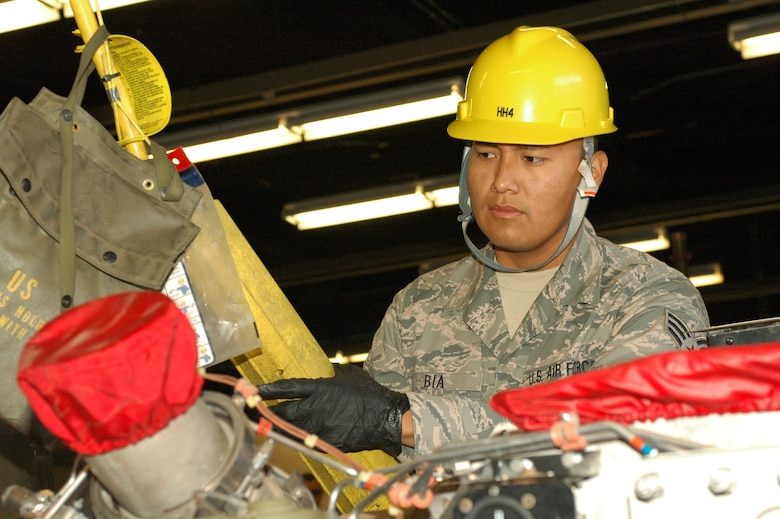 Senior Airman Andre Bia, an Aerospace Ground Equipment technician with the 162nd Fighter Wing, operates a lift to extract an engine from a piece of AGE. (U.S. Air Force photo by Staff Sgt. Heather Davis/Released)