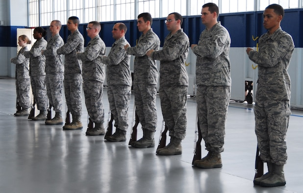 Members of the Maxwell Honor Guard practice ceremonial procedures while being observed by members of the Air Force Honor Guard team. Members of the Air Force Honor Guard from Joint Base Anacostia-Bolling, D.C. regularly travel to provide specialized training to base level honor guard members. (U.S. Air Force photo by Master Sgt. Michael Voss)