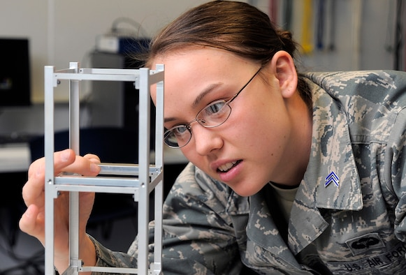 Cadet 1st Class Heather Nelson works on the FalconSat 7 project March 6, 2012. Nelson, an astronautical engineering major, is assigned to Cadet Squadron 16. (U.S. Air Force photo/Raymond McCoy)