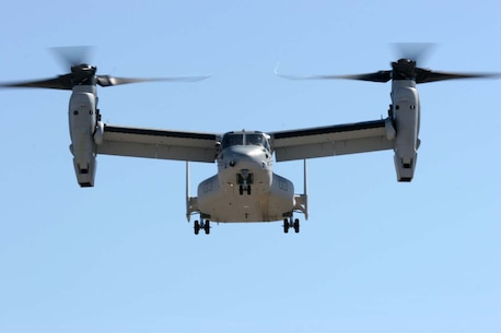 An MV-22B Osprey hovers in the sky as part of the Level III Demonstration during the 2012 Marine Corps Air Station Miramar Air Show, Oct. 13. This demonstration allowed spectators to observes the Osprey transition from helicopter to airplane mode.
