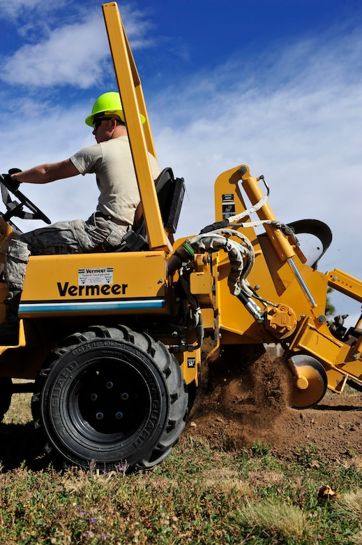 BUCKLEY AIR FORCE BASE, Colo. – Airman 1st Class Jonathan Delongralston, 460th Civil Engineer Squadron, drills a 743-foot hole for street light installation Oct. 16, 2012, along Aspen St. Delongralston operated a Vermeer V3550a pipe digger, which creates holes for future electrical lines. (U.S. Air Force photo by Airman 1st Class Darryl Bolden Jr.)