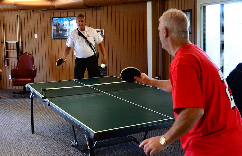 Teams compete in ping pong as one of 15 events at the Annual 94th Airlift Wing Team Day at Dobbins Air Reserve Base, Ga., Oct. 16. Team day is designed to promote team work and competitive spirit between units. (U.S. Air Force photo/ Senior Airman Elizabeth Van Patten)