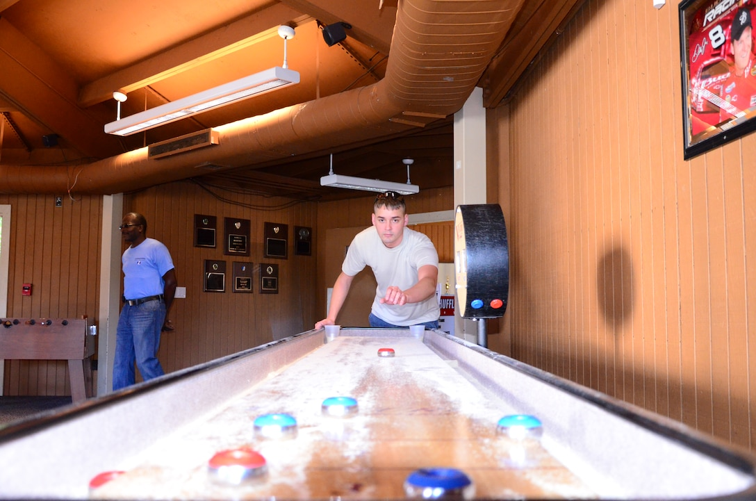 Teams compete in shuffleboard as one of 15 events at the Annual 94th Airlift Wing Team Day at Dobbins Air Reserve Base, Ga., Oct. 16. Team day is designed to promote team work and competitive spirit between units. (U.S. Air Force photo/ Senior Airman Elizabeth Van Patten)