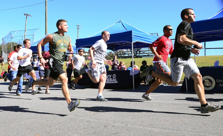 A fun run officially kicks off the Annual 94th Airlift Wing Team Day held at Dobbins Air Reserve Base, Ga., Oct. 16. Team day is designed to promote team work and competitive spirit between units. (U.S. Air Force photo/Senior Airman Elizabeth Van Patten)