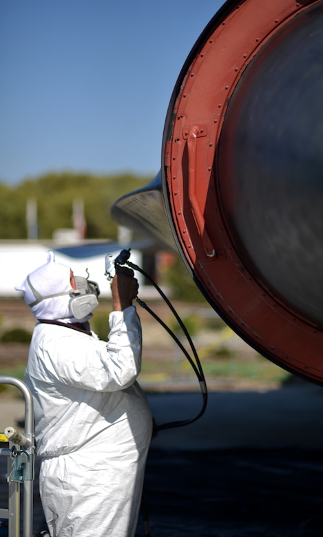 Rick Ashcraft paints the SR-71 Blackbird static display at Heritage Park, Beale Air Force Base, Calif., Sept. 29, 2012. The first Blackbird arrived at Beale in January 1966 and stayed until it was decommissioned Jan. 26, 1990. (U.S. Air Force photo by Airman 1st Class Andrew Buchanan)