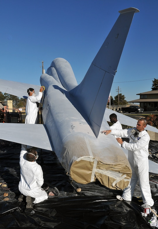 Employees of a Texas-based company restore a T-38 Talon static display at Beale Air Force Base, Calif., Oct. 16, 2012. The Talon static display is located at Beale's main entrance. (U.S. Air Force photo by Senior Airman Rebeccah Anderson/Released)