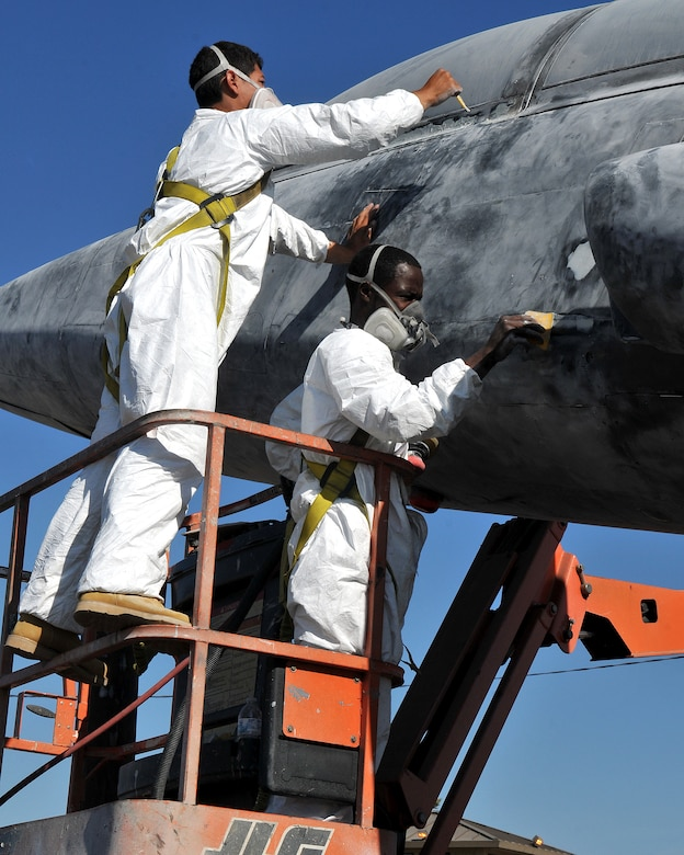 Employees of a Texas based company smooth putty onto imperfections before applying primer to a T-38 Talon static display at Beale Air Force Base, Calif., Oct. 14, 2012. The T-38 Talon is a twin engine supersonic jet trainer aircraft used at Beale to train U-2 Dragon lady pilots. (U.S. Air Force photo by Senior Airman Rebeccah Anderson/Released)