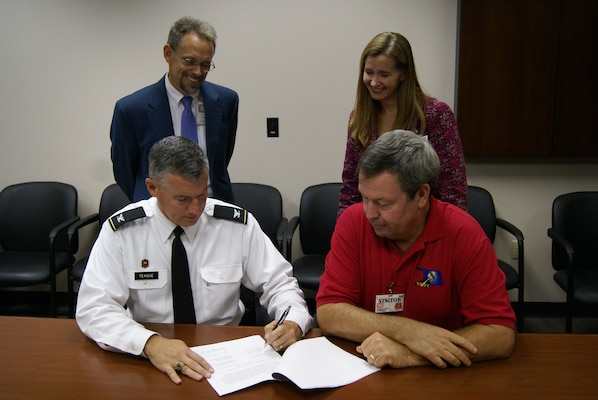 Tulsa District commander, Col. Michael Teague and David Streb, Oklahoma Department of Transportation director of engineering sign a memorandum of agreement between the two agencies.