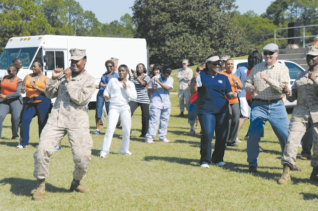 Cpl. Stephanie A. Bowens leads Marines and Civilian-Marines in a wobble dance during Marine Corps Logistics Base Albany's Employee Recognition Day at Covella Pond, Oct. 11.