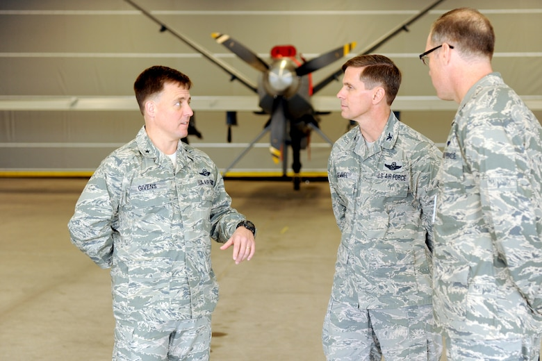 U.S. Air Force Brig. Gen. Robert P. Givens (left), Inspector General, Air Combat Command (ACC), meets with N.Y. Air National Guard Col. Greg A Semmel (middle), Commander, 174th Attack Wing, at Wheeler-Sack Army Airfield, Fort Drum, Watertown NY on October 20, 2012. Givens was visiting the 174th's MQ-9 Reaper Launch and Recovery element at Wheeler-Sack during the ACC's Compliance Inspection. (N.Y. Air National Guard photo by Tech. Sgt. Jeremy M. Call/Released)