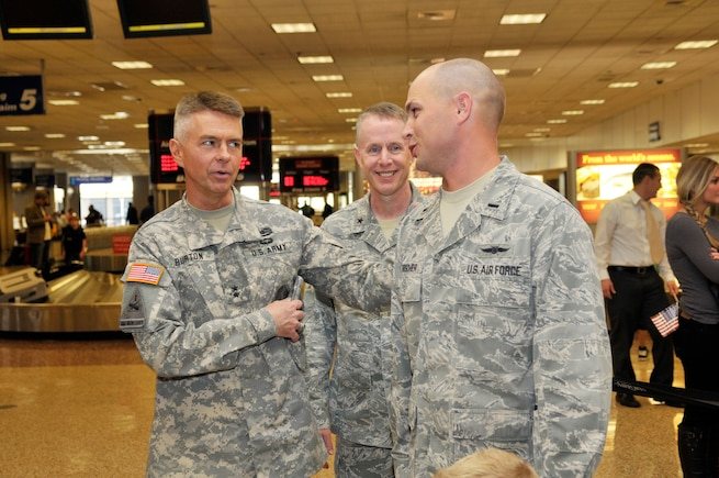 Brig. Gen. Jefferson Burton welcomes 1st Lt. Brian Herrscher, 130th Engineering Installation Squadron, as he arrives home from a six-month deployment to the Middle East at the Salt Lake City International Airport on Sunday Oct. 21, 2012. Herrscher, along with 13 others from the 130th EIS were deployed to the Middle East in support of Operation Enduring Freedom. (U.S. Air Force Photo by Tech. Sgt. Jeremy Giacoletto-Stegall/Released)