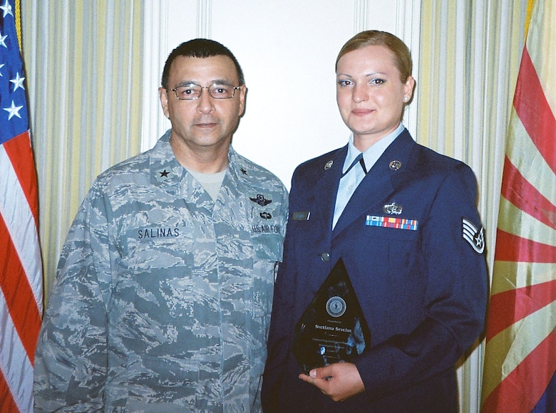 U.S. Air Force Staff Sgt. Svetlana Sevciuc received the Outstanding Analyst of the Year award from the Director Joint Staff of the Air National Guard Brig. Gen. Jose Salinas. Sgt. Sevciuc of the 162nd Fighter Wing Services Squadron uses her skills as an intelligence analyst to support the Arizona Joint Counter Narcotic-Terrorism Task Force mission. (U.S. Air Force photo/Released)