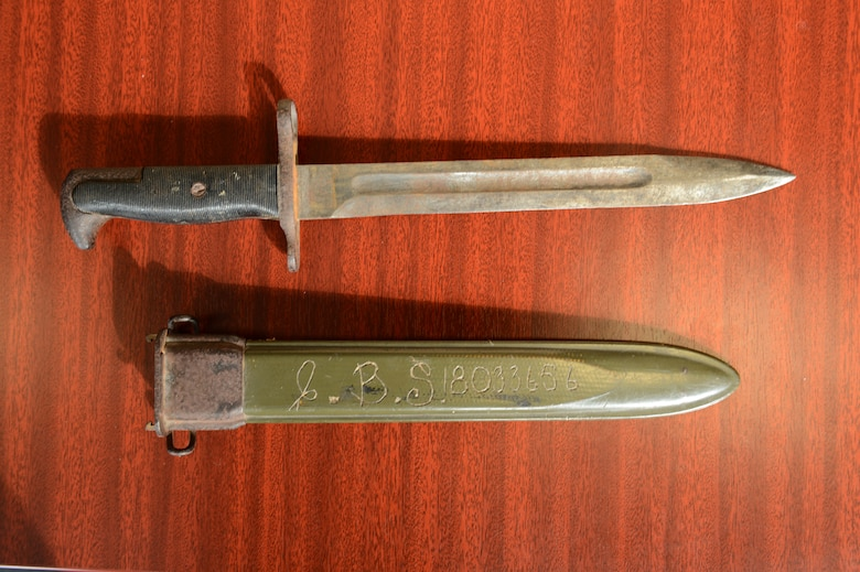 SPANGDAHLEM AIR BASE, Germany – A bayonet and sheath belonging to U.S. Army Pfc. Clyde Sparks lay on a table at the 606th Air Control Squadron Oct. 4, 2012. Sparks lost the bayonet in Luxembourg in 1944, and after 68 years the bayonet was returned to his family. (U.S. Air Force photo by Staff Sgt. Nathanael Callon/Released)