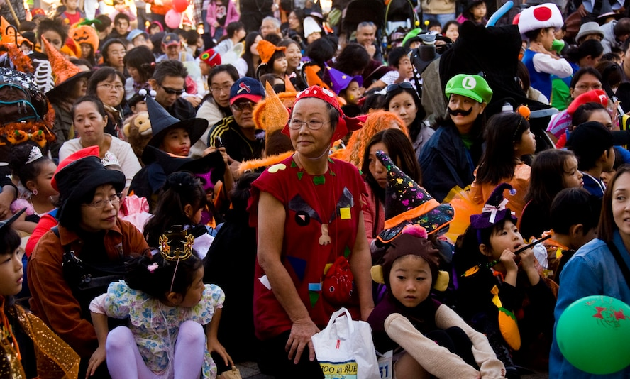 Thousands of Japanese and American citizens watch the costume contest during the Misawa Halloween Festival at Sky Plaza in Misawa City, Japan, Oct. 20, 2012. The Misawa Halloween Festival is an annual event where children and adults dress up and enjoy the season. (U.S. Air Force photo by Airman 1st Class Kenna Jackson)
