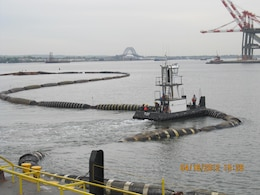 Dredged sand was used to cap or close the Newark Bay CDF. This photo shows the floating pipeline that connected the dredge to the pump barge at the CDF site.