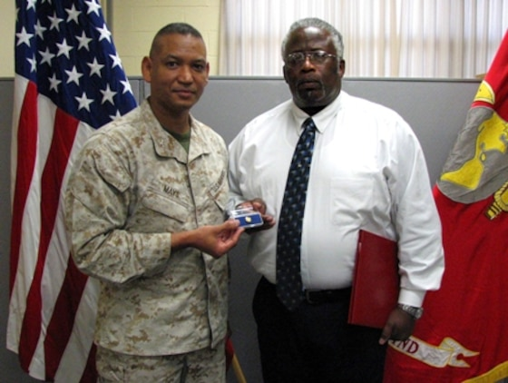 ALBANY, Ga. -Colonel Ed Mays, Marine Corps Systems Command's (MCSC) Assistant Commander for Acquisition Logistics and Product Support, presents James Harvey, an employee with the MCSC detachment in Albany, Ga., his 40-Year Federal Service pin. , MCSC Albany, 9/30/2012 10:11 AM