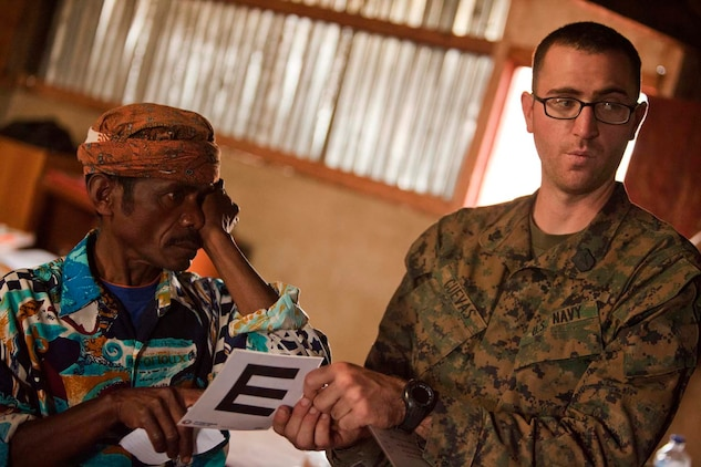 U.S. Navy Hospital Corpsman 3rd Class William Cuevas, 15th Marine Expeditionary Unit (MEU), gives an eye exam to Timorese patients in Koelek, Timor-Leste, during Exercise Crocodilo 2012, Oct. 15, 2012. Exercise Crocodilo is a bilateral training event between U.S. and Timor-Leste forces.