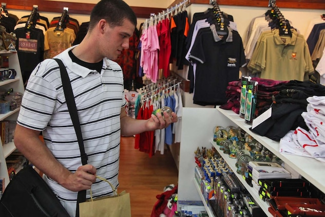 Lance Cpl. James Hastings, forward observer, Command Element, 15th Marine Expeditionary Unit, shops for souvenirs in a store at Darwin, Australia, Oct. 15. Marines and sailors from the 15th MEU and USS Rushmore stopped at their first liberty port in another nation, Darwin, Australia, during the MEU and Peleliu Amphibious Ready Group's Western Pacific deployment.