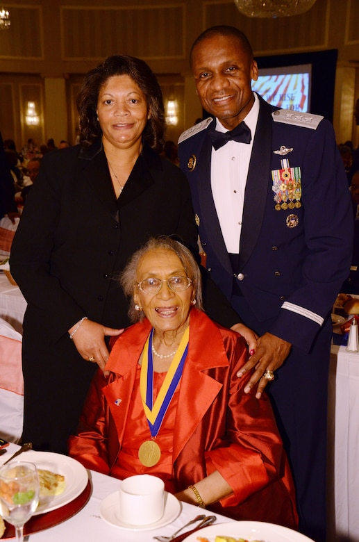 SCOTT AIR FORCE BASE, Ill. -- Lt. Gen. Darren McDew, 18th Air Force commander, and his wife, Evelyn, visit with Frankie Muse Freeman, Esq., an NAACP member and civil rights pioneer, Oct. 21, 2012 during the East St. Louis NAACP military appreciation banquet at the Millennium hotel in St. Louis, Mo. (U.S. Air Force photo/Master Sgt. Kimberly Spinner)