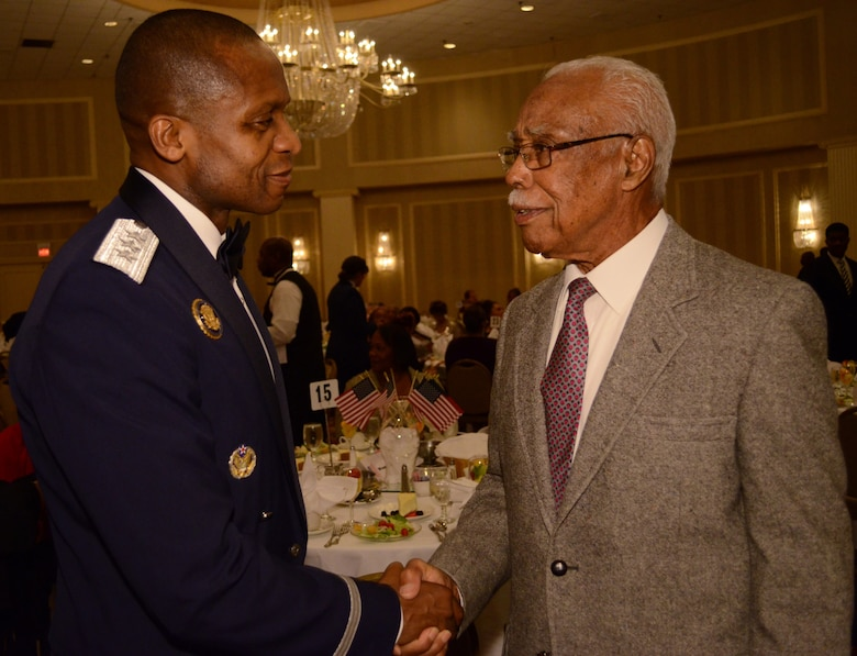 SCOTT AIR FORCE BASE, Ill. - Lt. Gen. Darren McDew, 18th Air Force commander, greets Christopher Newman, an orginal Tuskegee Airman, Oct. 21, 2012 during the East St. Louis NAACP Freedom Fund Banquet at the Millennium hotel in St. Louis, MO. (U.S. Air Force photo/Master Sgt. Kimberly Spinner)