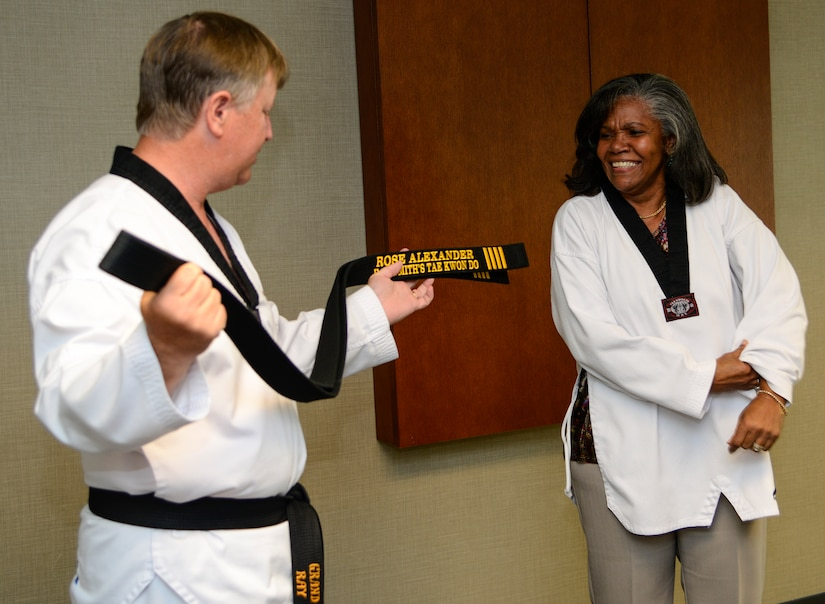 Grand Master Ray Smith, 8th degree Taekwondo black belt, presents an honorary fourth degree black belt to Rose Alexander, 628th Air Base Wing chief of external information at Joint Base Charleston – Air Base, S.C. October 22, 2012. Previously, only South Carolina governors Jim Hodges and Mark Sanford have been recognized by the USA Taekwondo Assoc.  (U.S. Air Force photo / Staff Sgt. Rasheen Douglas)